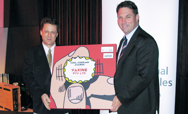 The Hon. Richard Marles, Parliamentary Secretary for Innovation, presents the AusIndustry Innovation Award to Vaxine Pty Ltd.