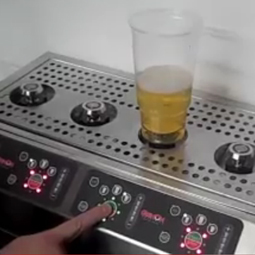 Lightning-fast, pour-from-the-bottom beer dispenser has some classy clients [VIDEO]