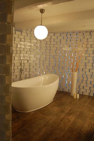 A bathroom wall made from $2 Rektangel vases