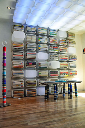 A wall and ceiling made from Ikea toy bins