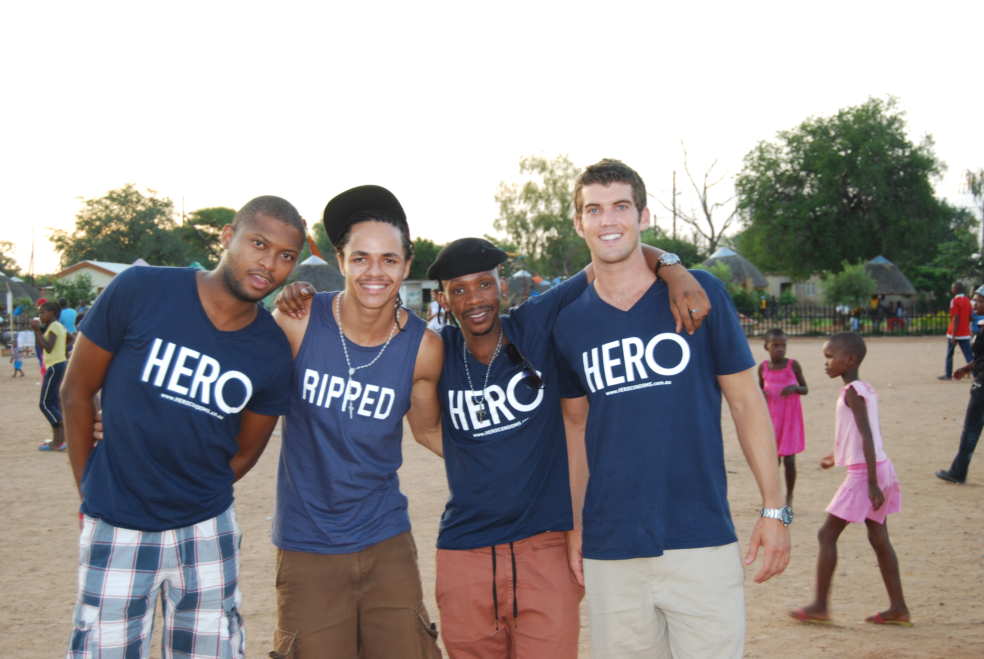 HERO CONDOMS founder Dustin Leonard with some of the youth he works with in Botswana